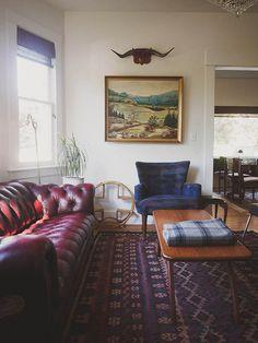 Leather Chesterfield / Pendleton Wingback Chair / Kilim Rug / Mid Century Pearsall Coffee Table / Bullhorns