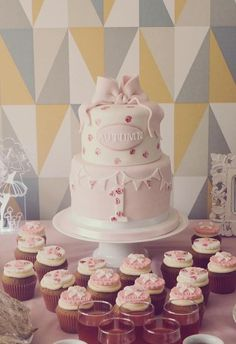 Pink bow cake with handpainted roses in a vintage style for a baby girl's first birthday
