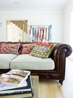 Masculine couch with a feminine, eclectic touch