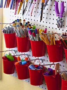Pair pails with a peg board for an attractive storage solution. | Community Post: 45 Organization Hacks To Transform Your Craft Room