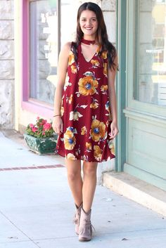 High neck, cut out dress with a fun, sunflower inspired print. Lined. Cut out in the front an back! Burgundy in color mixed with golden mustard, cream, and navy.