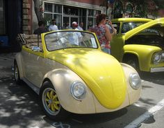 vw beetle yellow and creme conververtible. yellow wheels