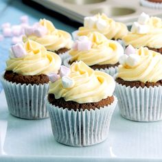 Evoking a decadent cup of hot chocolate, topped with Baileys-spiked whipped cream, these hot chocolate cupcakes have a surprise gooey centre and a rich creamy frosting that is guaranteed to please! If you want to serve the cakes warm, see tip below. #hotchocolate #chocolaterecipes #cupcakerecipes #chocolatecake #winterrecipes