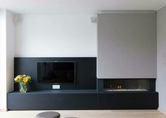 """Love the idea of """"hiding"""" a tv against a black background. As long as it doesn't darken the room too much."""
