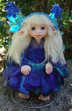 "OOAK Fantasy Fairy Polymer Clay Art Doll Sculpture ""Celia"" Fairies by J. Pollard Creations. $50.00, via Etsy."
