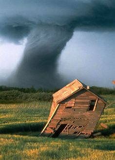 tornado and old building leaning