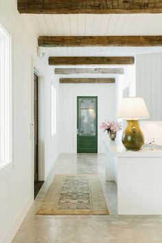 wood beams and white walls. Shiplap details and polished concrete floors so much texture in this space.