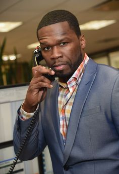 Can you hear him now? On Sept. 11, 2014 in New York 50 Cent helps raise funds during Cantor Fitzgerald's and BGC Partners' annual Charity Day event, which commemorates employees lost on Sept. 11