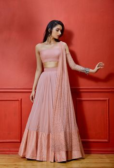 Salmon one cold shoulder net and georgette based blouse with embellished sleeve and attached dupatta. Featuring a georgette lehenga with silk pintucked border. Ethnic Outfits, Indian Outfits, Indian Wedding Outfits, Mode Bollywood, Bollywood Fashion, Indian Lehenga, Lehenga Choli, Western Lehenga, Blue Lehenga