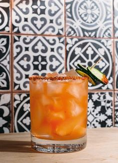 The Curcurbit - mezcal, Aperol, muddled cucumbers, lime juice