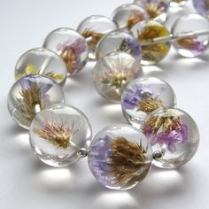 "Necklace | Sylwia Calus.  ""Tenerifian Flowers""   Handmade by artists; flowers embedded in resin, sterling silver"
