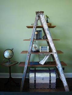 Repurposing an old ladder is one of my all time favorites!! If you'd prefer, put it on the deck or patio with plants and other outdoor items like watering cans etc. Fun all around!!