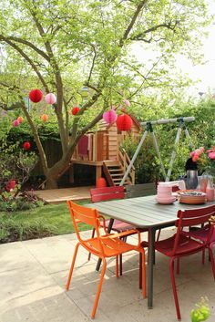 From the lounge area to the playhouse, this entire backyard is perfect for a family! fermob   outdoor furniture, patio furniture, colorful furniture