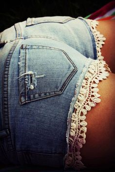 Cut old jeans and sew a lace trim on(: