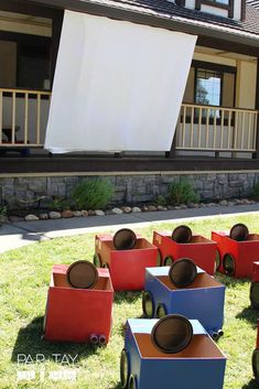 Check out the awesome cardboard box cars and screen at this Drive-in Movie Movie Night Party!! See more party ideas and share yours at CatchMyParty.com #catchmyparty #driveinmovienight #movienight #driveinmoviepartyactivity #boybirthdaypartyactivity
