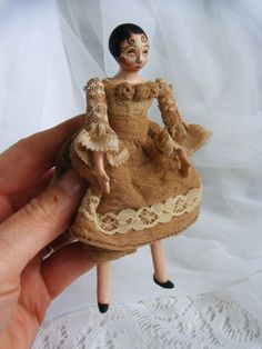 Scherer Miniature doll with a vintage folk art look.