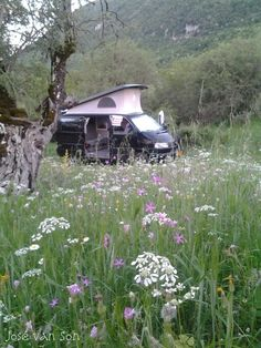 Freedom: Campsite with are VW Syncro campervan in spring at Kefalovriso near the Taxiachori monastery with view on the Albanian border,  the river and Mt. Gramos Greece