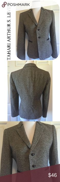 """TAHARI ARTHUR S LEVINE WOOL BLEND BLAZER Beautiful🔹Wool blend blazer with faux leather trim from Tahari Arthur S Levine🔹Lined🔹In excellent condition🔹Size 6: 22"""" length, 24"""" sleeves, 37"""" bust. 🔹Fabric:  40% wool, 20 acrylic, 18% polyester, 11% silk, 4 other. 🔹NO trades🔹Smoke free home🔹Bundle discount: 10% off two, 15% off three items🔹Thank you for visiting! Tahari Arthur S Levine Jackets & Coats Blazers"""