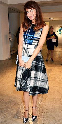 OLGA KURYLENKO Some might see this A-line plaid wool skirt and think that there was no way to make it sexy. But with a sequin top (also plaid), periwinkle clutch and print-adorned ankle-strap heels, Olga (at the Bianca Jagger Human Rights Foundation's benefit in London) certainly gives it her best shot.