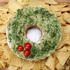 Here& what you need: 1 can refried beans shredded cheese pico de gallo sour cream guacamole 1 Tbsp. lime juice cilantro and 3 cherry tomato halves Christmas Appetizers, Christmas Treats, Christmas Cheese, Christmas Eve, Christmas Foods, Christmas Parties, Xmas Party, Family Christmas, Christmas Cookies