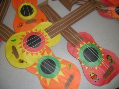 Cinco de Mayo Mariachi guitars = make the base out of cardboard to make them more sturdy then add construction paper details.Happy Cinco de Mayo Everybody! We had fun all this week learning about the Mexican culture. Mexican Maracas made from recycl. Mexico Crafts, Guitar Crafts, Crafts For Kids, Arts And Crafts, Festa Party, Thinking Day, Mexican Party, Elementary Art, Art Lessons