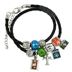 Where are you heading to this summer? This travel theme bracelet invokes all of the fun experiences that await. Travel Theme Bracelet / Enamel / Murano & B
