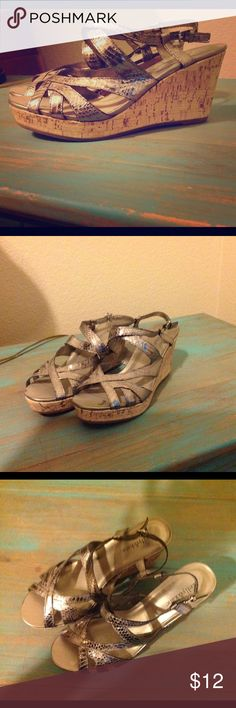 REDUCED! Pewter Snakeskin Wedge Sandals Kelly and Katie brand silver/pewter color strappy wedge sandals. Almond toe. Cork wedge. New w/o box. Kelly & Katie Shoes Wedges