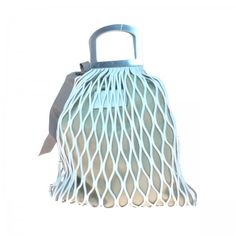 Laser cut leather tote. Brass top handle.