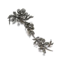 DIAMOND BROOCH, LATE 19TH CENTURY. Designed as a floral spray, the three detachable flower motifs set en tremblant, set with circular-cut and rose diamond, French assay marks, detaches into three segments, flower motifs may be worn with two additional hair pin fittings, fitted case stamped Vever.