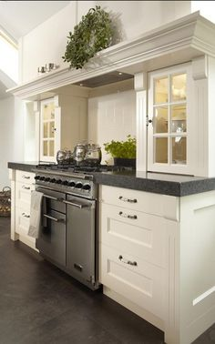 Kitchen cabinetry with lighting glass doors what a great treatment for counter cabinets