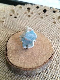 This beautiful ring was handmade using a uniquely shaped piece of ceramic that I found on a walk. The unique colors of salmon pink and ocean blue