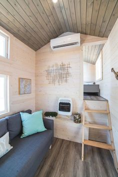 Built by Uncharted Tiny Homes, the 310-square-foot home has two built-in twin sized private bunks over the deck.