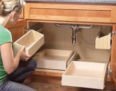 Loving this idea! roll out shelves under the sink <3