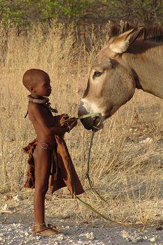 NAMIBIA - Himba girl with donkey