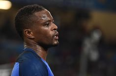 France's defender Patrice Evra reacts during the Euro 2016 group A football match between France and Albania at the Velodrome stadium in Marseille on June 15, 2016. / AFP / BERTRAND LANGLOIS