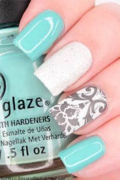 mint nails with gray flowers and white sparkle beads...elegant but simple