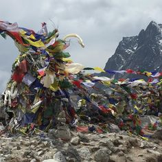 Prayer flags and stone monuments to the Trekkers and Sherpas who have lost their lives trying to conquer the  most dangerous mountain in the world  by everest4x