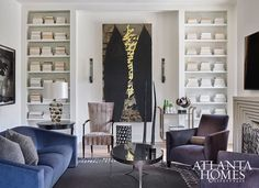 nook between bookcases for art with sconces.A large Donald Sultan painting commands attention in the family room, where Donghia furniture and a tall chair by Barbara Barry create a comfortable but elegant living space. Glam Living Room, Living Room Lounge, Living Room Update, Living Area, Living Room Furniture, Living Spaces, Living Rooms, Design Salon, Atlanta Homes
