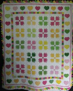bear paw quilt with heart applique border