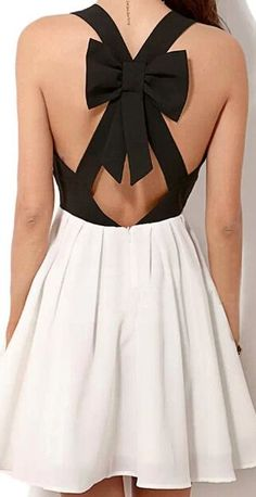 Cute white and black flirty dress with a bow on the back