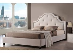 Displaying a highly arched headboard that's upholstered with button-tufted fabric in a neutral hue, this lovely platform bed brings sophistication to your master suite or guest bedroom.