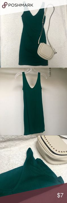 Ribbed Bodycon Dress Ribbed bodycon Dress in beautiful emerald green color, a little brighter than what the photos show. Worn and washed once. I think it is a size small, but the size tag is cut out. Clean, smoke-free.   Purse also for sale in my closet! Forever 21 Dresses Mini