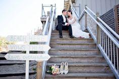 Beach wedding. Wedding photography inspiration. Michigan wedding. Bride and groom. Wedding staircase. Wedding shoes. Wedding bouquet of flowers. DIY wedding sign. Bride and groom.