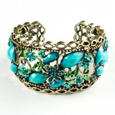 """Turquoise Marquise Resin Rhinestone and Painted Flower Bangle Bracelet Leisureland. $15.99. Easy on and off. Made with resin rhinestones. Diameter: 2.5"""". Lead compliant. Extendable to fit various wrist sizes"""