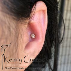 Conch Piercing by Kenny Crespo at New Flower Studio in Long Beach, CA.  Yellow Gold flower by NeoMetal.