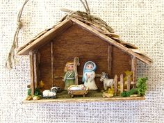 The nativity ornament has five hand painted porcelain figures. The stable is constructed of wood with stones and foliage. Nativity Ornaments, Christmas Nativity, Whimsical, Polymer Clay, Porcelain, Scene, Hand Painted, Bird, Etsy