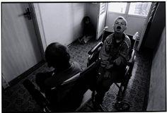 BELARUS. 1997. Novinki Asylum, Minsk. Three boys in a hallway.    Paul Fusco/Magnum Photos