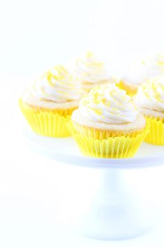 Lemon Curd Cupcakes Recipe on twopeasandtheirpod.com Lemon cupcakes filled with lemon curd and topped with buttercream frosting. The perfect cupcake!