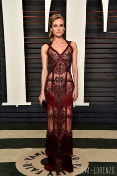 REEM ACRA | worn by Diane Kruger at the 2016 Vanity Fair Oscars Party. red carpet. evening dress. embellishments. sheer. straps. bohemian. crimson.
