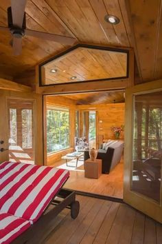 A 400 sq ft comfy cottage in a forest, with an enclosed porch and fireplace.